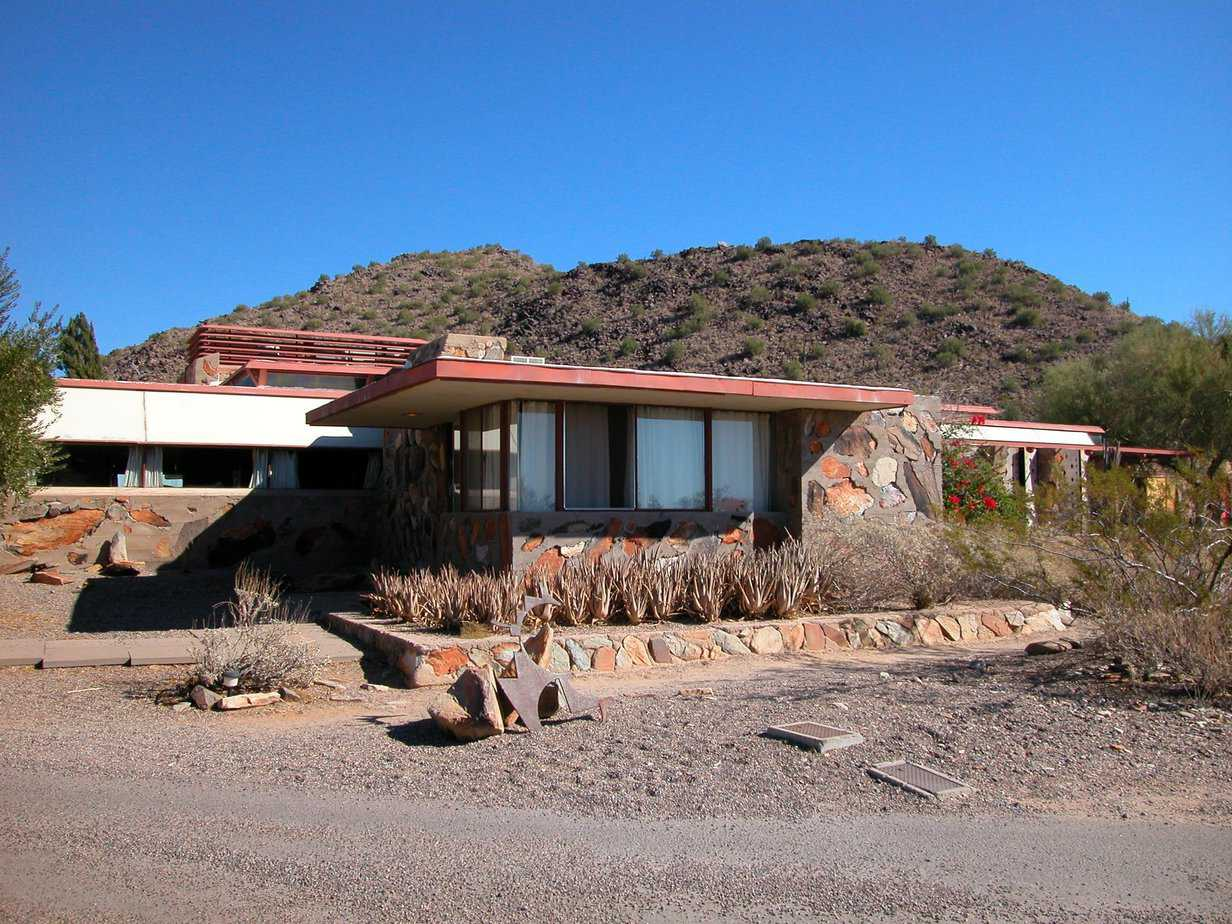 Flat roofed, stone house in desert.