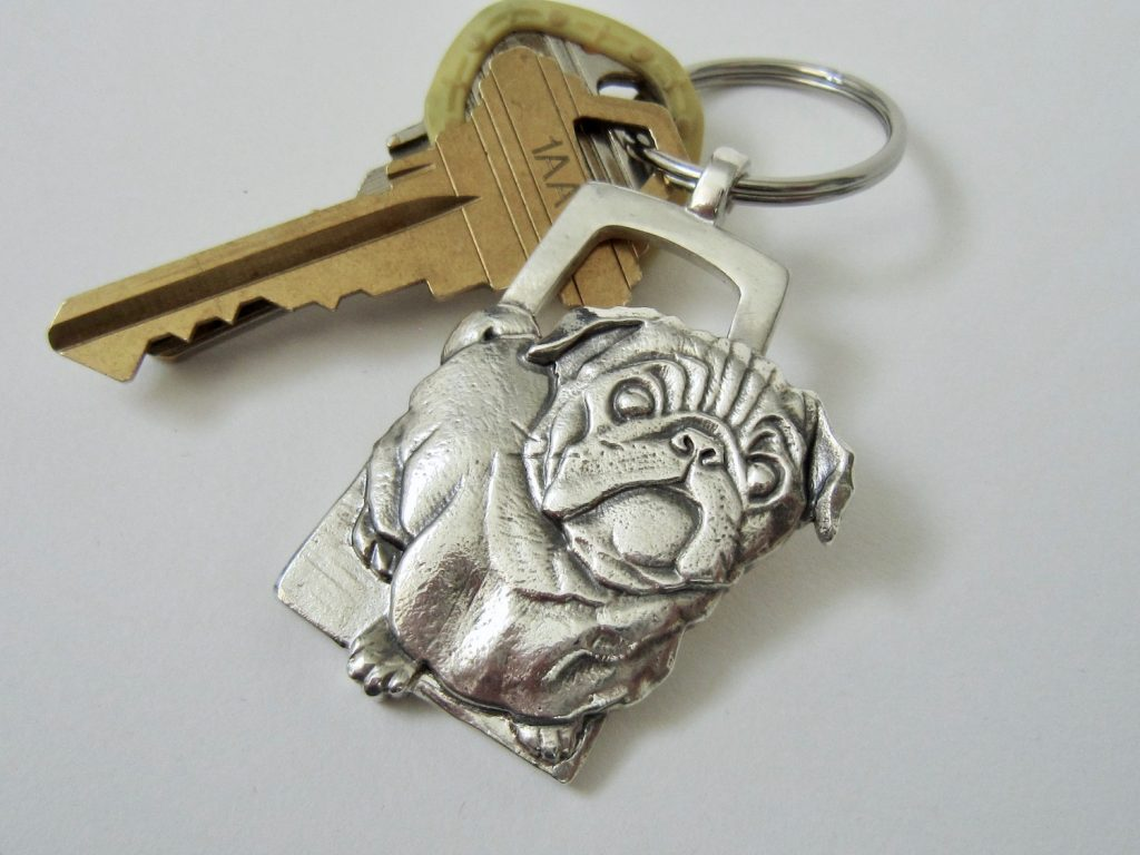 Key Chain, with hand carved pug dog as the key chain. Sterling Silver.
