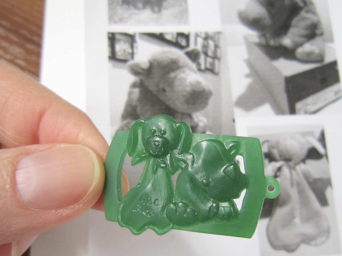 Wax carving with images in the background.
